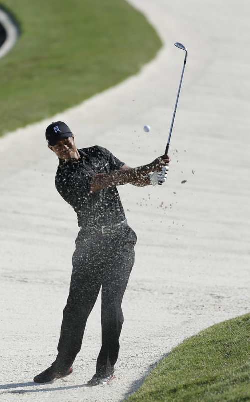 Tiger Woods hits from the sand on the 11th hole during the second round of The Players championship golf tournament at TPC Sawgrass, Friday, May 10, 2013 in Ponte Vedra Beach, Fla. (AP Photo/Chris O'Meara)