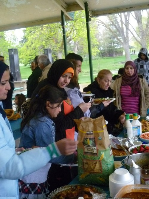 Courtesy of Justin Harnish Refugee families gather for a Mother's Day Celebration in 2011, hosted by Women of the World. The group's leaders hope to find permanent classroom space and volunteer English teachers.
