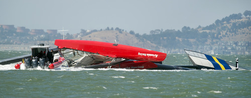 """The Artemis Racing AC72 catamaran, an America's Cup entry from Sweden, lies capsized after turning over during training in San Francisco Bay on Thursday, May 9, 2013, in San Francisco. Artemis Racing said Andrew """"Bart"""" Simpson, an Olympic gold medalist from Great Britain, died after the capsized boat's platform trapped him underwater for about 10 minutes. (AP Photo/Noah Berger)"""
