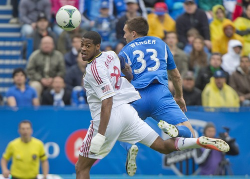 Montreal Impact's Andrew Wenger, right, and Real Salt Lake's Chris Schuler go up for the ball during the second half of an MLS soccer game in Montreal, Saturday, May 11, 2013. (AP Photo/The Canadian Press, Graham Hughes)