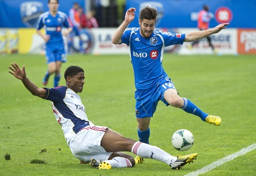 Montreal Impact's Blake Smith, right, leaps over the sliding challenge by Real Salt Lake's Khari Stephenson during the second half of an MLS soccer game in Montreal, Saturday, May 11, 2013. (AP Photo/The Canadian Press, Graham Hughes)
