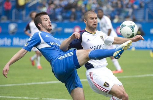 Montreal Impact's Jeb Brovsky, left, tackles Real Salt Lake's Chris Wingert during the first half of an MLS soccer game in Montreal, Saturday, May 11, 2013. (AP Photo/The Canadian Press, Graham Hughes)