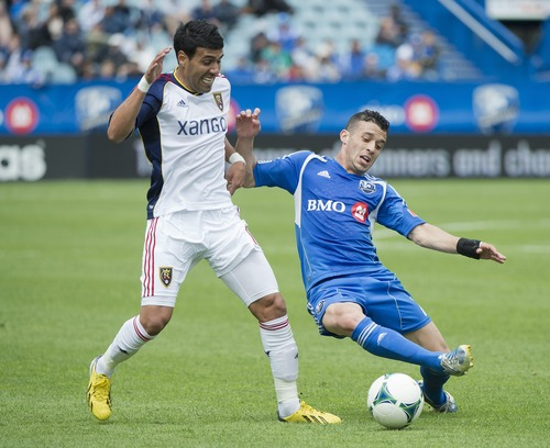 Montreal Impact's Felipe Martins, right, battles for the ball with Real Salt Lake's Javier Morales during the first half of an MLS soccer game in Montreal, Saturday, May 11, 2013. (AP Photo/The Canadian Press, Graham Hughes)