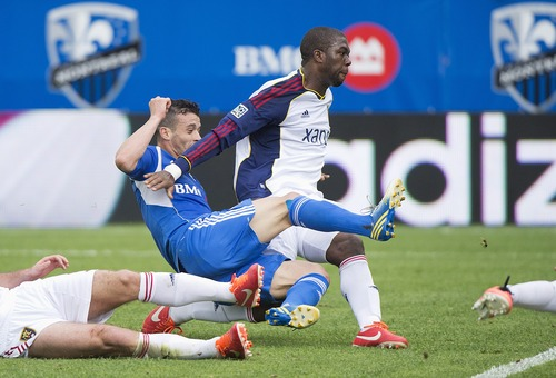 Montreal Impact's Felipe Martins, left, scores against Real Salt Salt Lake's Kwame Watson-Siriboe defends during the first half of an MLS soccer game in Montreal, Saturday, May 11, 2013. (AP Photo/The Canadian Press, Graham Hughes)