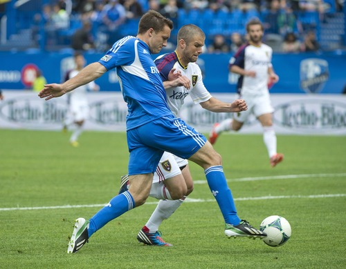 Montreal Impact's Andrew Wenger, left, tackles Real Salt Lake's Chris Wingert during the first half of an MLS soccer game in Montreal, Saturday, May 11, 2013. (AP Photo/The Canadian Press, Graham Hughes)