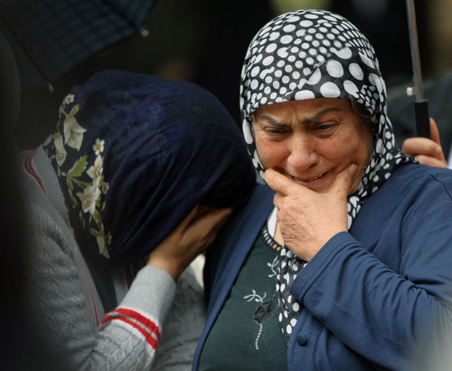 Mourning relatives cry as pallbearers carry the coffin of Fehmi Karaca, 69, a shop owner and one 46 victims killed in Saturday explosions for burial in Reyhanli, near Turkey's border with Syria, Sunday, May 12, 2013. The bombings marked the biggest incident of cross-border violence since the start of Syria's bloody civil war and have raised fear of Turkey being pulled deeper into the conflict. (AP Photo/Burhan Ozbilici)