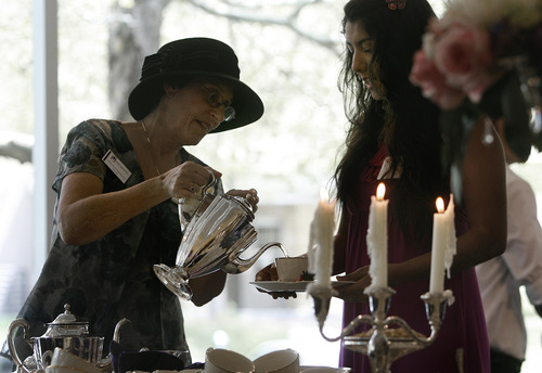 Scott Sommerdorf   |  The Salt Lake Tribune Debi Levin-Stankevich, left, pours tea for Alexia Martinez as Westminster College Woman's Board hosts its 97th Annual Silver Tea. The traditional Silver Tea event includes a silent auction, bake sale, flowers and plants, children's crafts and a High Tea. All proceeds go toward Westminster student scholarships, Saturday, May 11, 2013.