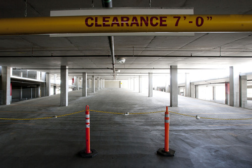Steve Griffin   The Salt Lake Tribune  Two parking garages at the Jordan Valley TRAX station in West Jordan sit mostly empty, one partially closed and the other completely closed by UTA to save on maintenance costs. Thursday May 9, 2013.