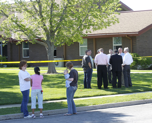 Al Hartmann  |  The Salt Lake Tribune Church leaders and neighbors survey damage as Unified Fire Authority responds to a fire at an LDS Church building at 7525 W. 3735 South on Monday morning May 13.