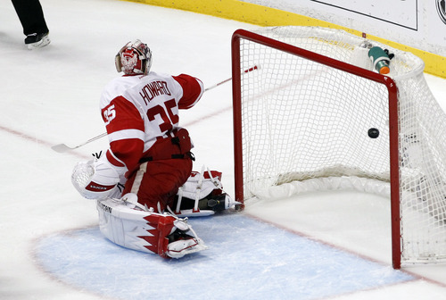 Detroit Red Wings goalie Jimmy Howard is scored on by Anaheim Ducks right wing Emerson Etem during the first period in Game 7 of their first-round NHL hockey Stanley Cup playoff series in Anaheim, Calif., Sunday, May 12, 2013. (AP Photo/Chris Carlson)
