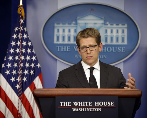 """White House press secretary Jay Carney during his daily news briefing at the White House in Washington, Wednesday, May, 8, 2013.  Carney charged Wednesday that the continued scrutiny of the administration's behavior around last year's attack in Benghazi is little more than yet another of Republicans' """"attempts to politicize"""" the issue. (AP Photo/Pablo Martinez Monsivais)"""