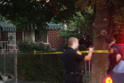 Kim Raff | The Salt Lake Tribune Police investigate a fatal shooting on Grant Street in Salt Lake City, Utah on July 28, 2012.