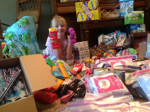 Courtesy | Colleen Leonard  Alia Leonard, 7, raises packs birthday bags filled with donated toys, games, treats and more to give to needy children. The Sandy girl wanted to make sure every child received a birthday present, regardless of their economic situation.