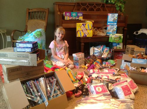 Courtesy of Colleen Leonard Alia Leonard, 7, raises packs birthday bags filled with donated toys, games, treats and more to give to needy children. The Sandy girl wanted to make sure every child received a birthday present, regardless of their economic situation.