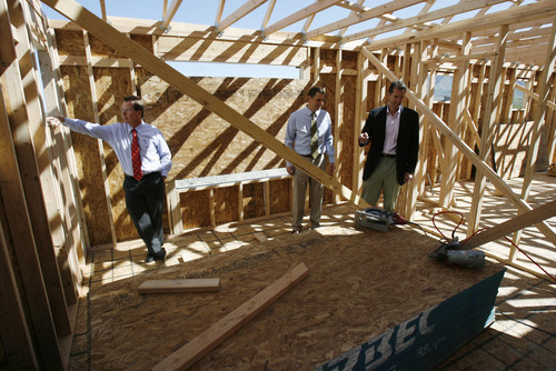 Francisco Kjolseth  |  The Salt Lake Tribune Clark Ivory, left, CEO of Ivory Homes, the biggest homebuilder in Utah, tours one of the many new homes being built in Stansbury Park along with CFO Rick Lifferth, center, and Jim Seaberg, president of Ivory Commercial. Ivory Homes has completed 15,000 houses over the years. It's been the top homebuilder in the state for at least 23 years and has been hugely influential in how homes in northern Utah look.