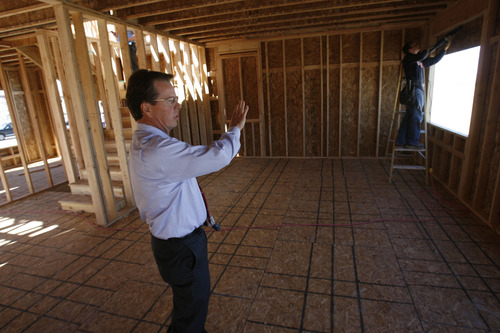 Francisco Kjolseth  |  The Salt Lake Tribune Clark Ivory, CEO of Ivory Homes, the biggest homebuilder in Utah, tours one of the many new homes being built in Stansbury Park. Ivory Homes has completed 15,000 houses over the years. It's been the top homebuilder in the state for at least 23 years and has been hugely influential in how homes in northern Utah look.