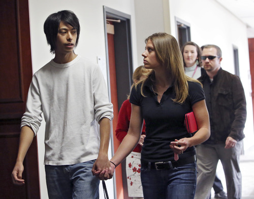 Family members and victims are escorted to the courtroom for a hearing where Aurora theater shooting suspect James Holmes asked a judge to enter a plea of not guilty by reason of insanity, Monday, May 13, 2013, in Centennial, Colo. (AP Photo/Ed Andrieski)