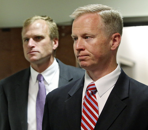 District Attorney George Brauchler, right, and assistant DA Mark Hurlbert arrive for a hearing in Centennial, Colo., where Aurora theater shooting suspect James Holmes was allowed to change his plea to not guilty by reason of insanity on Monday, May 13, 2013. (AP Photo/Ed Andrieski)