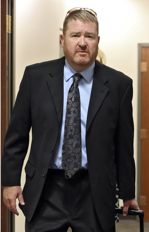 Defense attorney Daniel King arrives at court for a hearing where his client, Aurora theater shooting suspect James Holmes, was allowed to change his plea to not guilty by reason of insanity, in Centennial, Colo., on Monday,  May 13, 2013. (AP Photo/Ed Andrieski)