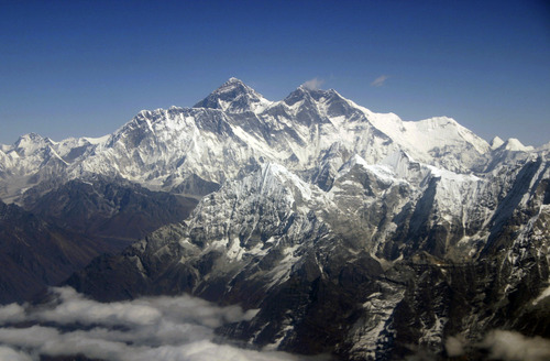 FILE - This Oct. 21, 2005 file photo shows Mount Everest from an aerial view taken over Nepal. (AP Photo/Jody Kurash, File)