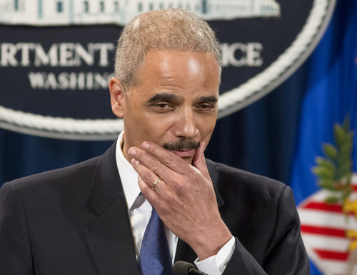 Attorney General Eric Holder pauses during a news conference at the Justice Department in Washington, Tuesday, May 14, 2013. Holder said he's ordered a Justice Department investigation into the Internal Revenue Service's targeting of conservative groups for extra tax scrutiny.   (AP Photo/J. Scott Applewhite)