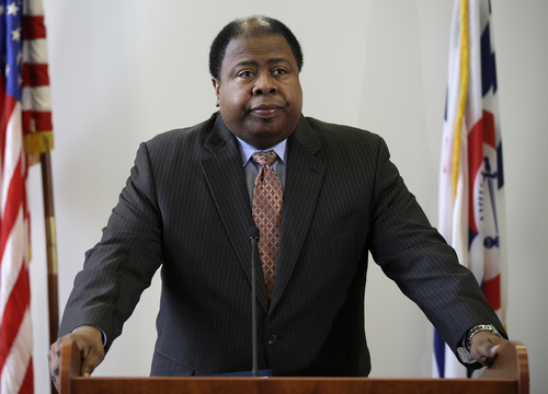 Cincinnati city manager Milton R. Dohoney, Jr. speaks at a news conference, Tuesday, May 14, 2013, in Cincinnati, where Cincinnati police chief James Craig announced he has accepted the position as chief of police in Detroit. (AP Photo/Al Behrman)