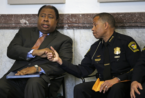 Cincinnati police chief James Craig, right, shakes hands with city manager Milton R. Dohoney, Jr., Tuesday, May 14, 2013, in Cincinnati, where Craig announced he has accepted the position as chief of police for the city of Detroit. (AP Photo/Al Behrman)