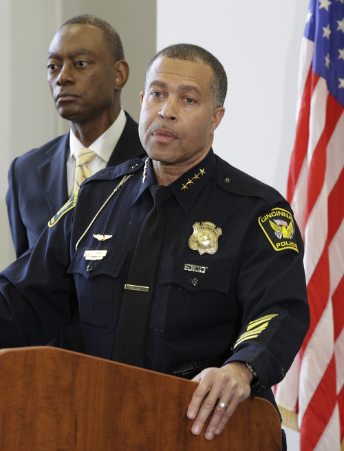 Cincinnati police chief James Craig speaks at a news conference, Tuesday, May 14, 2013, in Cincinnati, where he announced he has accepted the position as chief of police for the city of Detroit. Cincinnati mayor Mark Mallory listens at left. (AP Photo/Al Behrman)