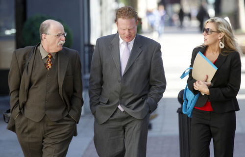 Al Hartmann  |  The Salt Lake Tribune Jeremy Johnson, center, walks to Federal Court in Salt Lake City Wednesday April 10, 2013, with his defense lawyers Ron Yengich, left, and Chelsea Koch for his initial appearance on an indictment on conspiracy, fraud and money laundering in connection to his I Works company.