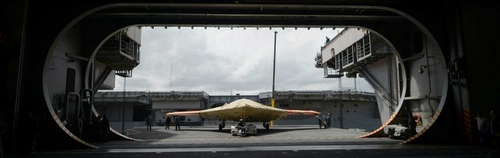 In this image provided by the U.S. Navy an X-47B Unmanned Combat Air System demonstrator sits on an aircraft elevator of the aircraft carrier USS George H.W. BushMonday May 6, 2013. The George H.W. Bush is scheduled to be the first aircraft carrier to catapult-launch an unmanned aircraft from its flight deck Tuesday May 14, 2013. (AP Photo/US Navy, Specialist 2nd Class Tony D. Curtis)