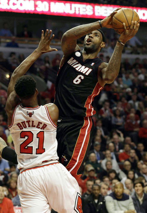 Miami Heat forward LeBron James (6) goes up for a shot against Chicago Bulls forward Jimmy Butler (21) during the first half of Game 4 of an NBA basketball playoffs Eastern Conference semifinal on Monday, May 13, 2013, in Chicago. (AP Photo/Nam Y. Huh)