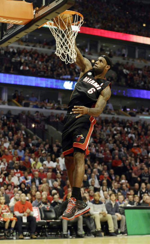 Miami Heat forward LeBron James (6) dunks during the first half of game 4 of an NBA basketball playoffs Eastern Conference semifinal against the Chicago Bulls on Monday, May 13, 2013, in Chicago. (AP Photo/Nam Y. Huh)
