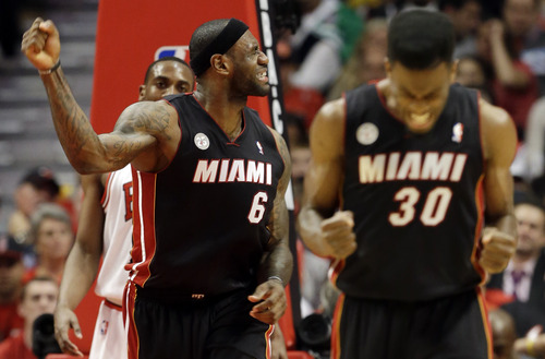 Miami Heat's LeBron James (6) and Norris Cole (30) react during the second half of Game 4 of an NBA basketball playoffs Eastern Conference semifinal against the Chicago Bulls on Monday, May 13, 2013, in Chicago. (AP Photo/Nam Y. Huh)