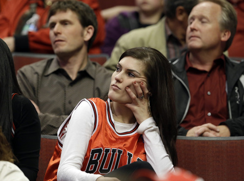 A Chicago Bulls fan reacts during the second half of Game 4 of an NBA basketball playoffs Eastern Conference semifinal against the Miami Heat on Monday, May 13, 2013, in Chicago. The Heat won 88-65. (AP Photo/Nam Y. Huh)