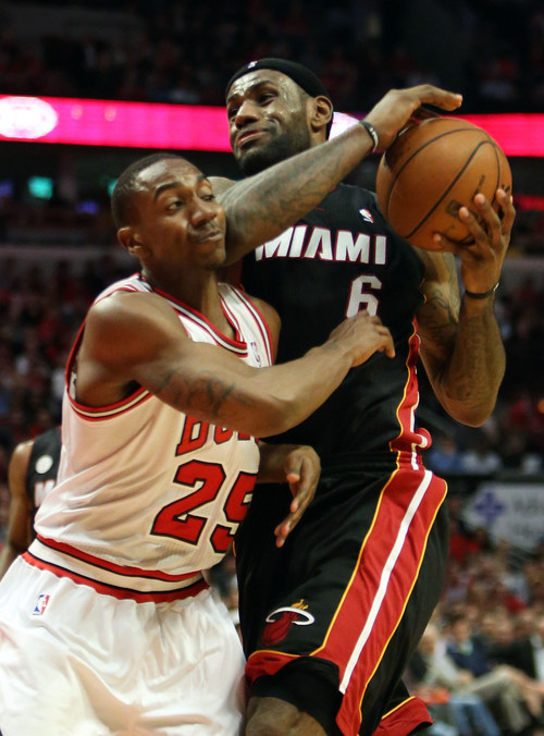 Miami Heat forward LeBron James drives on Chicago Bulls guard Marquis Teague during  Game 4 of an NBA basketball playoffs Eastern Conference semifinal of the Chicago Bulls against the Miami Heat on Monday, May 13, 2013, in Chicago. The Heat won 88-65. MANDATORY CREDIT, MAGS OUT, TV OUT (AP photo / Daily Herald,  Steve Lundy )