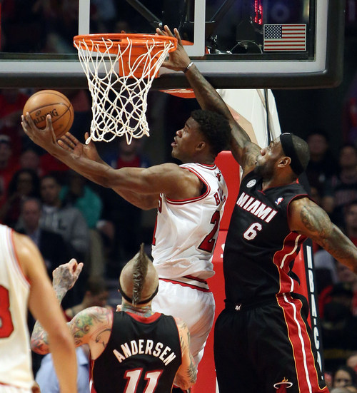 Chicago Bulls forward Jimmy Butler drives past Miami Heat forward LeBron James during  Game 4 of an NBA basketball playoffs Eastern Conference semifinal of the Chicago Bulls against the Miami Heat on Monday, May 13, 2013, in Chicago. The Heat won 88-65. MANDATORY CREDIT, MAGS OUT, TV OUT (AP photo / Daily Herald,  Steve Lundy )