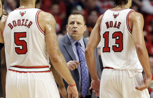 Chicago Bulls head coach Tom Thibodeau talks to his team during a timeout in the first half of Game 4 of an NBA basketball playoffs Eastern Conference semifinal against the Miami Heat on Monday, May 13, 2013, in Chicago. (AP Photo/Nam Y. Huh)