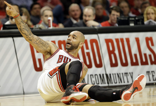 Chicago Bulls forward Carlos Boozer talks to an official during the second half of Game 4 of an NBA basketball playoffs Eastern Conference semifinal against the Miami Heat on Monday, May 13, 2013, in Chicago. (AP Photo/Nam Y. Huh)