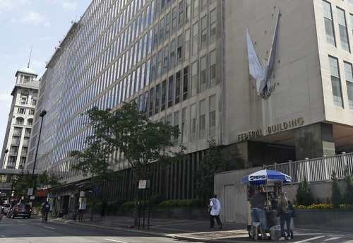 "The John Weld Peck Federal Building, shown Tuesday, May 14, 2013, in Cincinnati, houses the main offices for the Internal Revenue Service in the city. The IRS apologized Friday for what it acknowledged was ""inappropriate"" targeting of conservative political groups during the 2012 election to see whether they were violating their tax-exempt status. In some cases, the IRS acknowledged, agents inappropriately asked for lists of donors. The agency blamed low-level employees in a Cincinnati office, saying no high-level officials were aware.(AP Photo/Al Behrman)"