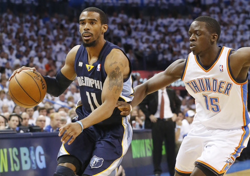 Memphis Grizzlies point guard Mike Conley (11) is defended by Oklahoma City Thunder point guard Reggie Jackson (15) during the first half of Game 5 of their Western Conference Semifinals NBA basketball playoff series in Oklahoma City, Wednesday, May 15, 2013. (AP Photo/Sue Ogrocki)