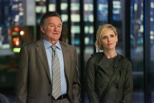 """This publicity image released by CBS shows Robin Williams, left, and Sarah Michelle Gellar in a scene from the pilot episode of """"The Crazy Ones,"""" a new CBS comedy premiering in the fall of 2013. (AP Photo/CBS, Richard Cartwright)"""