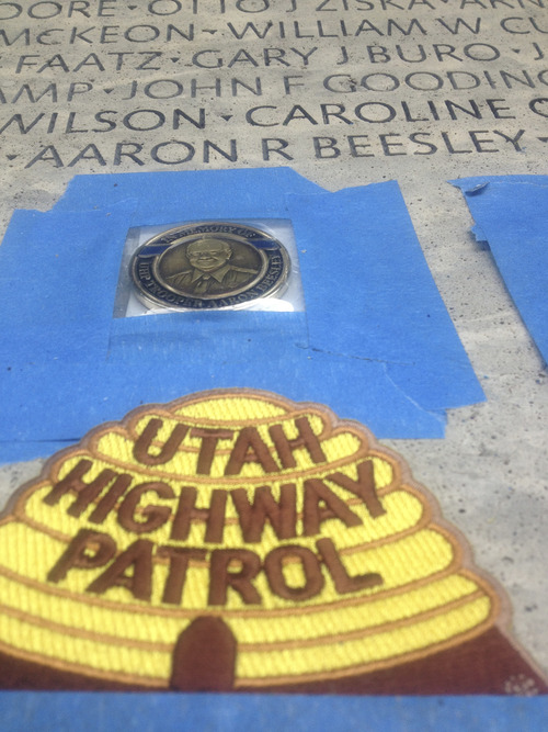 Thomas Burr | The Salt Lake Tribune A Utah Highway Patrol emblem sits below Trooper Aaron Beesley's name on the National Peace Officers Memorial in Washington, D.C. Beesley was killed in a a rescue operation last year and was honored Wednesday, May 15, 2013, in the nation's capital.