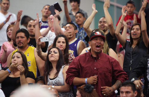 Steve Griffin | The Salt Lake Tribune   Hometown fans cheer as Utah's Larry Gomez is announced the winner over Deandre Harris, of Iowa, following their 152 pound bout during the Golden Gloves boxing tournament at the Salt Palace Convention Center in Salt Lake City, Utah Tuesday May 14, 2013.
