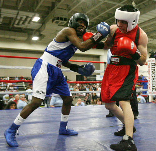 Steve Griffin | The Salt Lake Tribune   Utah's Isaac Aguliar, right, lands a right hand tot he chin of Sharone Carter, of St. Louis, during Golden Gloves boxing tournament at the Salt Palace Convention Center in Salt Lake City, Utah Wednesday May 15, 2013. Aguliar defeated Carter.