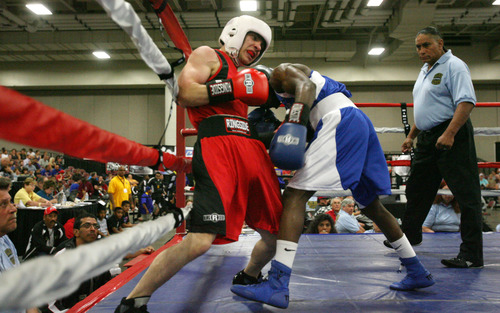 Steve Griffin | The Salt Lake Tribune   Utah's Isaac Aguliar, left, battles Sharone Carter, of St. Louis, during Golden Gloves boxing tournament at the Salt Palace Convention Center in Salt Lake City, Utah Wednesday May 15, 2013. Aguliar defeated Carter.
