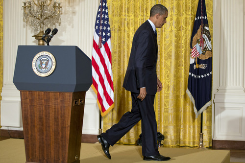 President Barack Obama walks from the podium after speaking on the Internal Revenue Service's targeting of conservative groups for extra tax scrutiny in the East Room of the White House in Washington, Wednesday May 15, 2013. Obama announced the resignation of Acting IRS Commissioner Steven Miller, the top official at the IRS.  (AP Photo/Jacquelyn Martin)