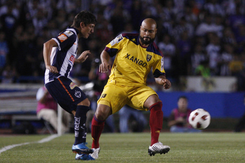 Mexico's Monterrey Neri Cardoso, left, fights for the ball with U.S. Real Salt Lake Robbie Isaac Russell during a Concacaf Champions League first leg final soccer match in Monterrey, Mexico, Wednesday, April 20, 2011. (AP Photo/Miguel Tovar)