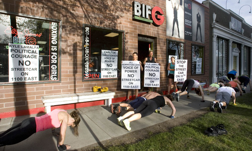 Paul Fraughton  |  The Salt Lake Tribune Eliza James, who is adamantly opposed to the streetcar line on 1100 East in Sugar House, mixes exercising her opinions with exercising her clients as they do burpees along 1100 East in front of her Sugar House boxing gym.