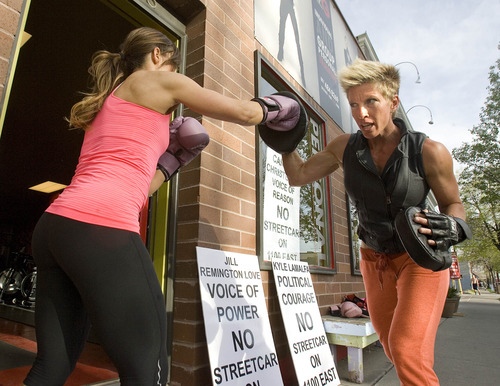 Paul Fraughton  |  The Salt Lake Tribune Raquel Ramon, left, works with Eliza James at James' boxing gym in Sugar House.                        Monday, April 29, 2013
