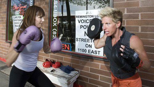 Paul Fraughton  |  The Salt Lake Tribune Sarah Scott, left, works with Eliza James at James' boxing gym in Sugar House.
